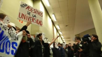 Spain: Protesters storm Madrid university denouncing 'terrorists' Felipe Gonzalez and Juan Luis Cebrian