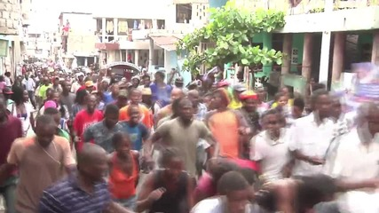 Haiti: Protesters dodge bullets in march against alleged electoral fraud