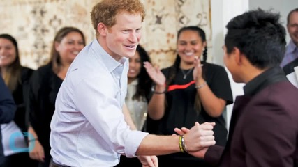 Prince Harry Jokes Around and Puts a Purple Handprint on a Photographer's Head