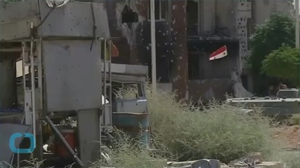 Syrian Insurgents Advance in Captured Town