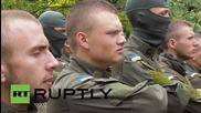 Ukraine: Azov Battalion recruits compete on obstacle course
