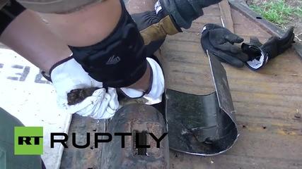 Спасяване на коте от метална тръба
