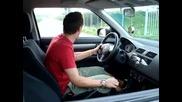 Guy immitates driving a car