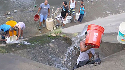 Venezuela: Citizens collect sewage water for household use