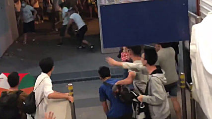 Hong Kong: Masked men storm station, assault anti-govt. protesters