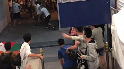 Hong Kong: Masked men storm station, assault anti-govt. protesters