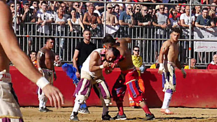 Italy: Modern-day Florentine gladiators slug it out in ancient ultraviolent footy game