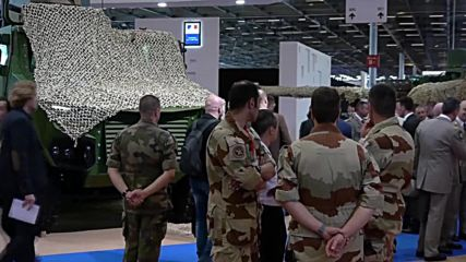 France: Peace activists throw red paint on French tank at Paris arms fair