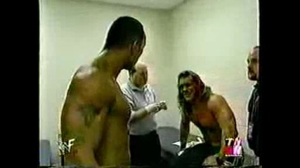Rock and Jericho fight at the lockeroom