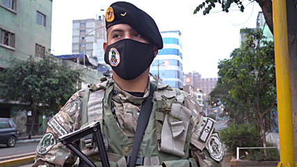 Peruvian soldiers in hip-hop face-off with coronavirus on Lima streets