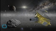 Pluto Probe Survives Encounter, Phones Home