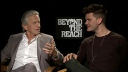Michael Douglas And Jeremy Irvine in 'Beyond The Reach' Interview