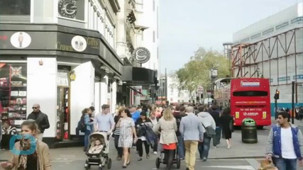 Crowd Lifts London Bus Off Injured Unicyclist