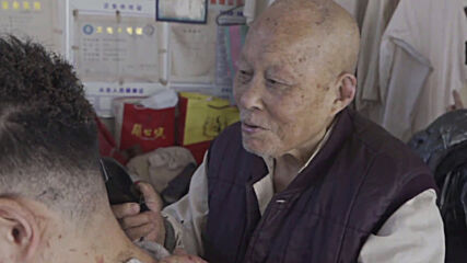 Feel the burn! 91 y/o Chinese barber uses hot iron bar to trim hair