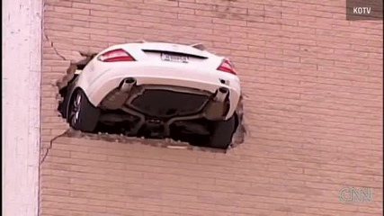 A car backed up through a wall in a Tulsa, Oklahoma, parking garage.