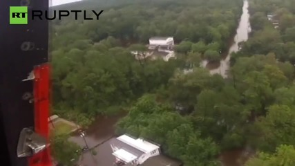 Mother and Baby Trapped in Flood Rescued from Rooftop by Helicopter