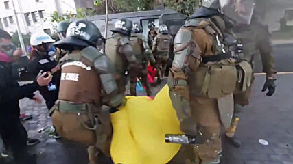 Chile: Police use pepper spray against protester in Pikachu costume