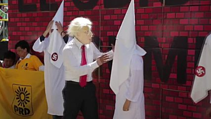 Mexico: 'Trump' cavorts with KKK in Mexico City protest