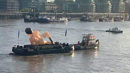 UK: Giant Borat statue floats down the Thames to promote sequel