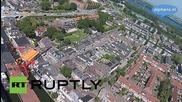 Нидерландия: Дрон заснема падането на кран в река Рейн
