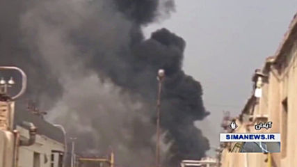Iran: Smoke billows from fire in oil refinery's waste canal