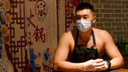 Not just a pretty face! Topless male model waiters attract customers at Chinese restaurant