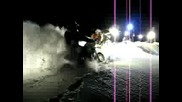 Ktm two stroke rider hacking his way through deep snow, using his helmet light and mounted head ligh