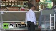 Russia: Medvedev fills his sweet tooth during confectionery store visitx
