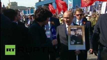 Russia: Putin talks of his father on Immortal Regiment march