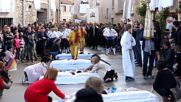 Spain: 'Devils' jump over babies in Spanish festival