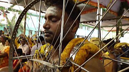 Hindu worshippers have piercing, fiery devotion