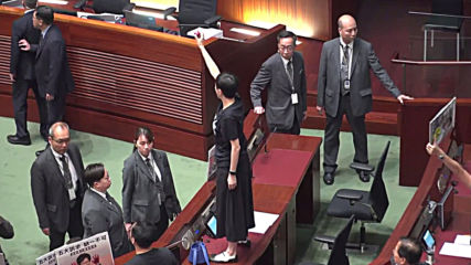 Hong Kong: Carrie Lam forced to halt policy address amid heckling in LegCo