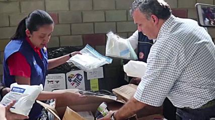 Colombia: Puerto Rican aid unloaded at Venezuela border