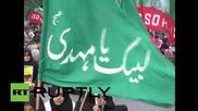 Горене на американски и израелски знамена в Карачи