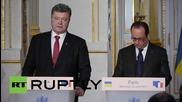 France: Poroshenko and Hollande agree to bolster OSCE