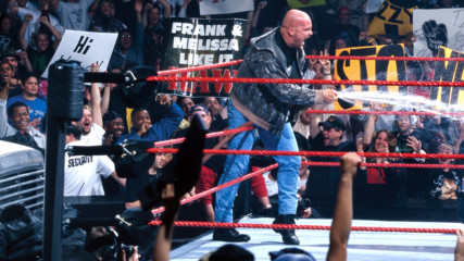 """Stone Cold"" Steve Austin gives The Corporation a beer bath"