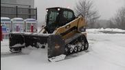 Как се чисти сняг с Cat 277c демонстрация