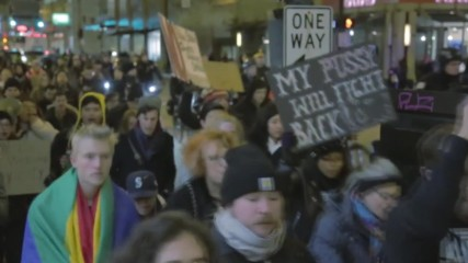 USA: Anti-Trump protesters march outside Trump Tower, Chicago