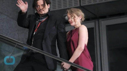 Johnny Depp's Wife Charged in Doggie Debacle