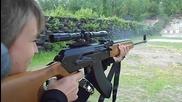 Pretty girl shooting scoped Saiga 7.62x39