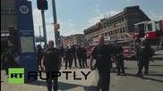 USA: Baltimore police pepper-spray protesters after shooting