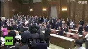 Japan: MPs scuffle in parliament as panel approves contentious security bill