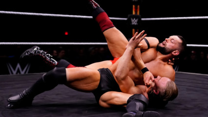 Finn Bálor and Ilja Dragunov trade strikes in the center of the ring: WWE Worlds Collide, Jan. 25, 2020