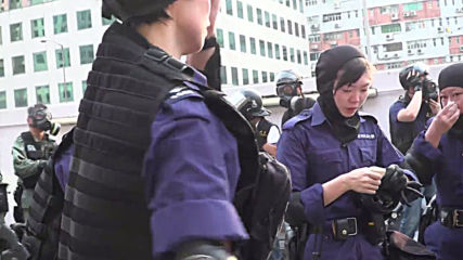 Hong Kong: Police double over in agony during shopping mall skirmish