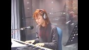 Heechul playing the paino and singing