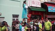 Hong Kong: Children get high in annual bun festival