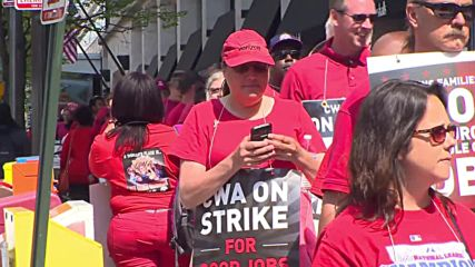 USA: Some 900 striking Verizon workers march outside DC office