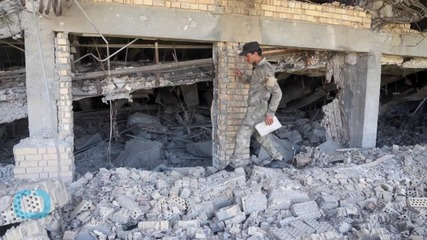 Saddam's Tomb Suffers Extensive Damage in Fighting as Iraqi Security Forces Battle for Tikrit