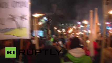 Estonia: Torch-wielding anti-refugee protesters gather on Latvian border