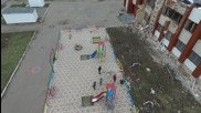 Ukraine: Drone captures children playing amongst rubble in decimated Nikishino